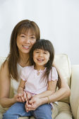 Asian mother and daughter hugging — Stock Photo