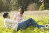 Young couple relaxing in the grass — Stock Photo