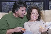 Senior Hispanic couple reading newspaper — Stock Photo