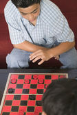 Two boys playing checkers — Stock Photo