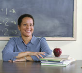 Teacher sitting at her desk — Stock Photo