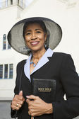 Senior African American woman in front of church — Stock Photo