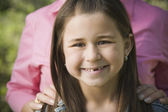 Close up of young Hispanic girl smiling — ストック写真