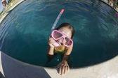 Girl in swimming pool wearing goggles — Стоковое фото