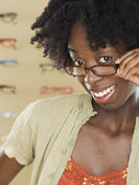 Young woman trying on new glasses — Stock Photo