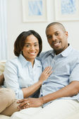 Portrait of African couple on sofa — Stock Photo