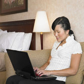 Asian woman typing on laptop12 — Stock Photo