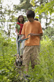 Family hiking with dog — Stock Photo