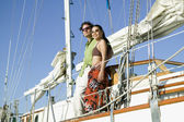 Low angle view of couple on sailboat — Stock Photo