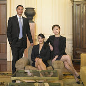Businesspeople sitting in lobby — Stock Photo