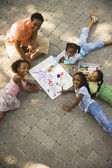 African mother coloring with daughters — Stock Photo