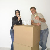 Couple eating take out on boxes in new house — Stock Photo