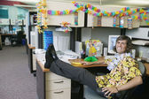 Full length businessman in Hawaiian decorated office — Stock Photo