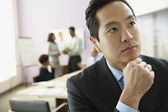 Asian businessman thinking — Stock Photo
