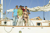 Portrait of multi-ethnic friends on sailboat — Stock Photo