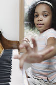 Portrait of girl playing piano — Stock Photo