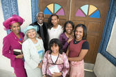 African American Reverend and parishioners in front of church — Stock Photo