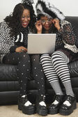 Senior African women looking at laptop — Stock Photo
