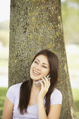 Hispanic woman talking on cell phone — Stock Photo