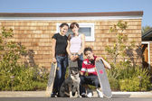 Portrait of teenagers with dog and skateboards — Stock Photo