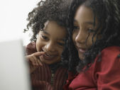 Brother and sister using a laptop — Stock Photo