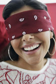 Hispanic woman wearing blindfold — Stock Photo