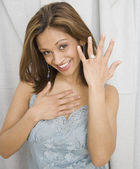Indian woman showing off engagement ring — Stock Photo