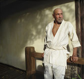 Portrait of man in karate outfit — Stock Photo