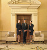 Businesspeople standing in waiting area — Stock Photo
