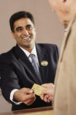 Businessman accepting credit card payment — Stock Photo