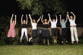 Group of Hispanic women jumping — Stock Photo
