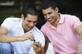 South American men looking at cell phone — Stock Photo