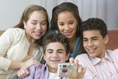 Four teenagers posing for picture — Stock Photo