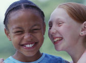 Close up portrait of two girls giggling — Stock Photo