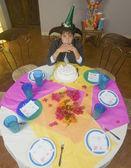 Hispanic boy alone with birthday cake — Stock Photo