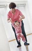 Asian grandmother playing with granddaughter — Stockfoto
