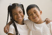 Young friends smiling for the camera — Stock Photo