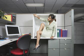 Businesswoman exiting office cubicle — Stock Photo