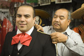 Young man being fitted for a matador outfit — Stock Photo