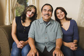 Portrait of Hispanic family on sofa — Stock Photo