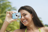 South American woman taking photograph — Stock Photo