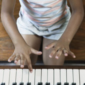 Midsection of girl playing piano — Stock Photo