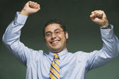 Hispanic businessman cheering — Stock Photo