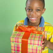Portrait of African boy holding gift — Stock Photo