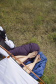 Legs and feet of couple sticking out of tent — Stock Photo