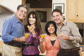 Two middle-aged couples with cocktails — Stock Photo