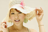 Close up of woman wearing straw hat — Stock Photo