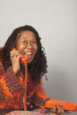Senior African woman talking on telephone — Stock Photo