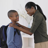 African mother seeing son off the school — Stock Photo