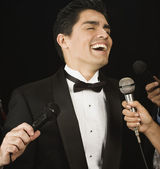 Male celebrity laughing for the press — Stock Photo